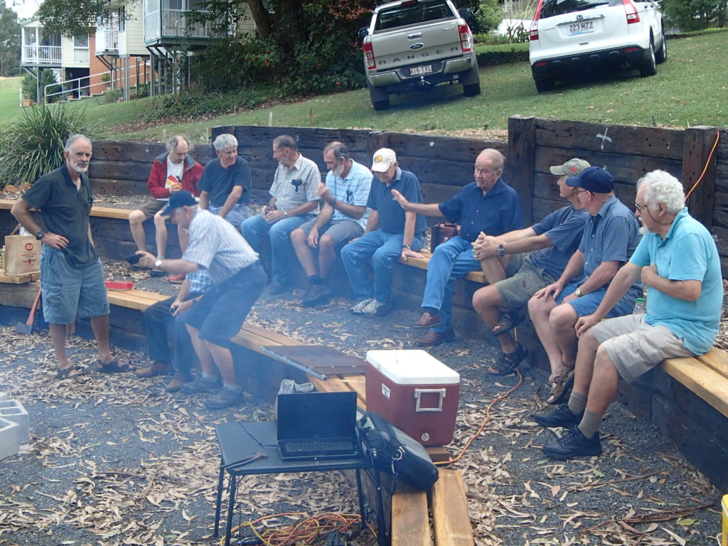 Photo of Band of Broters enjoing a BBQ at the Amphitheatre at the church